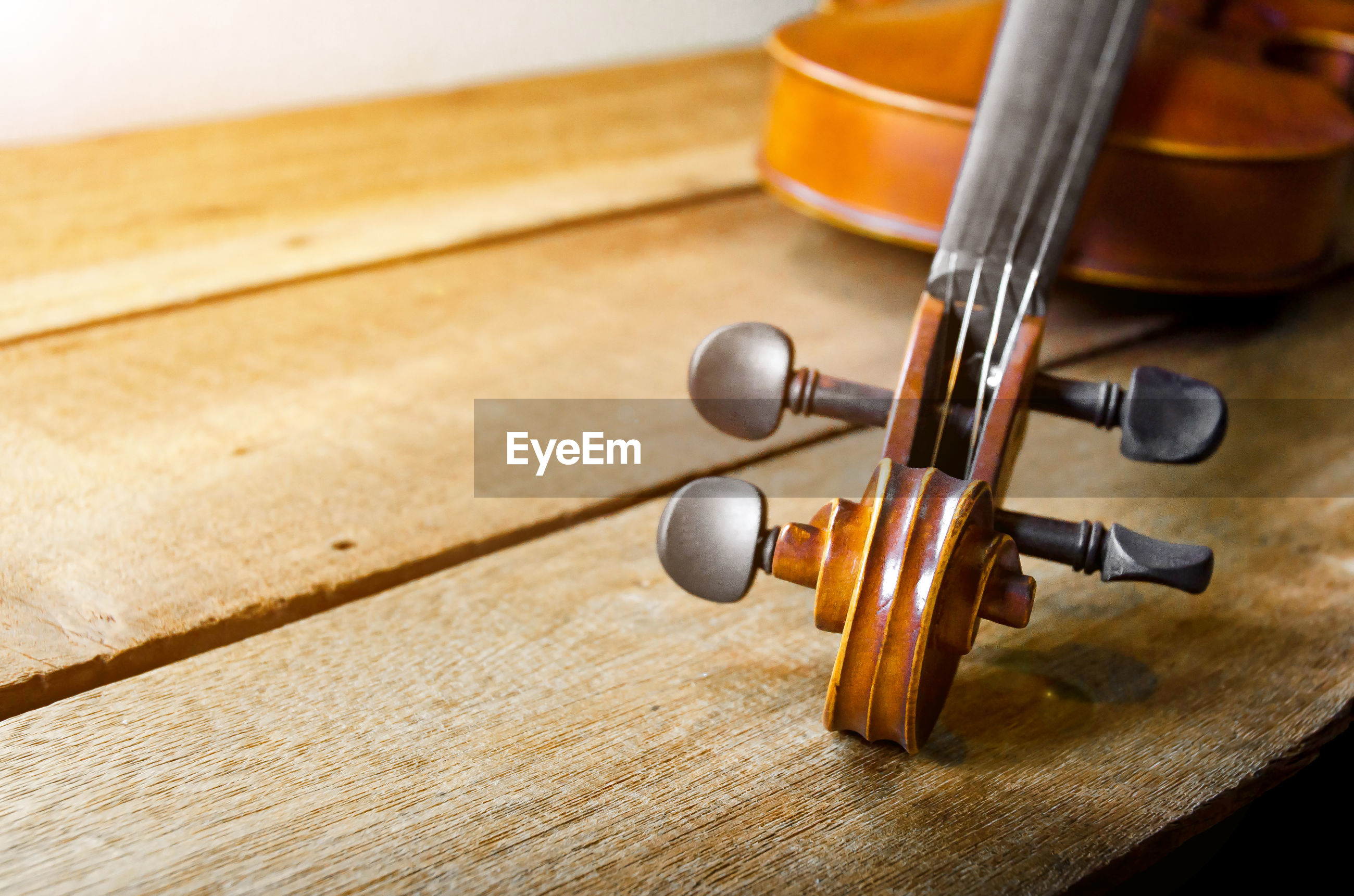 Close-up of violin on wooden table