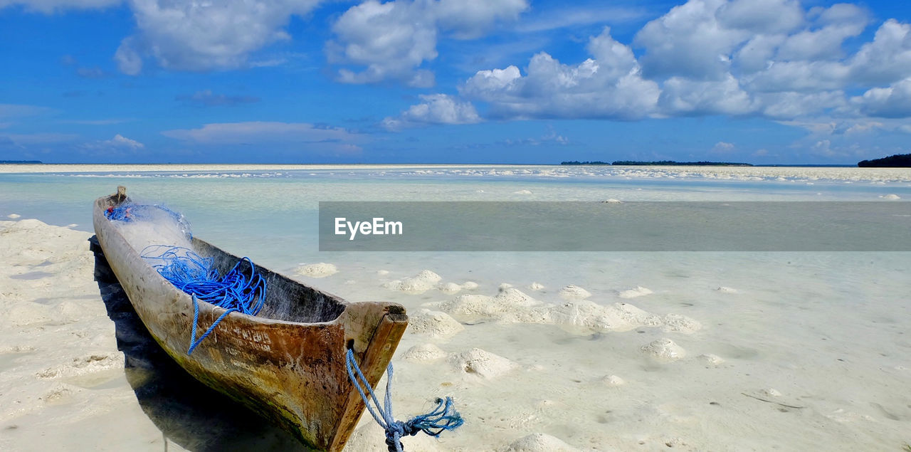 sea, beach, sky, water, horizon over water, land, horizon, cloud - sky, scenics - nature, beauty in nature, tranquil scene, nature, tranquility, sand, nautical vessel, blue, day, moored, no people, outdoors