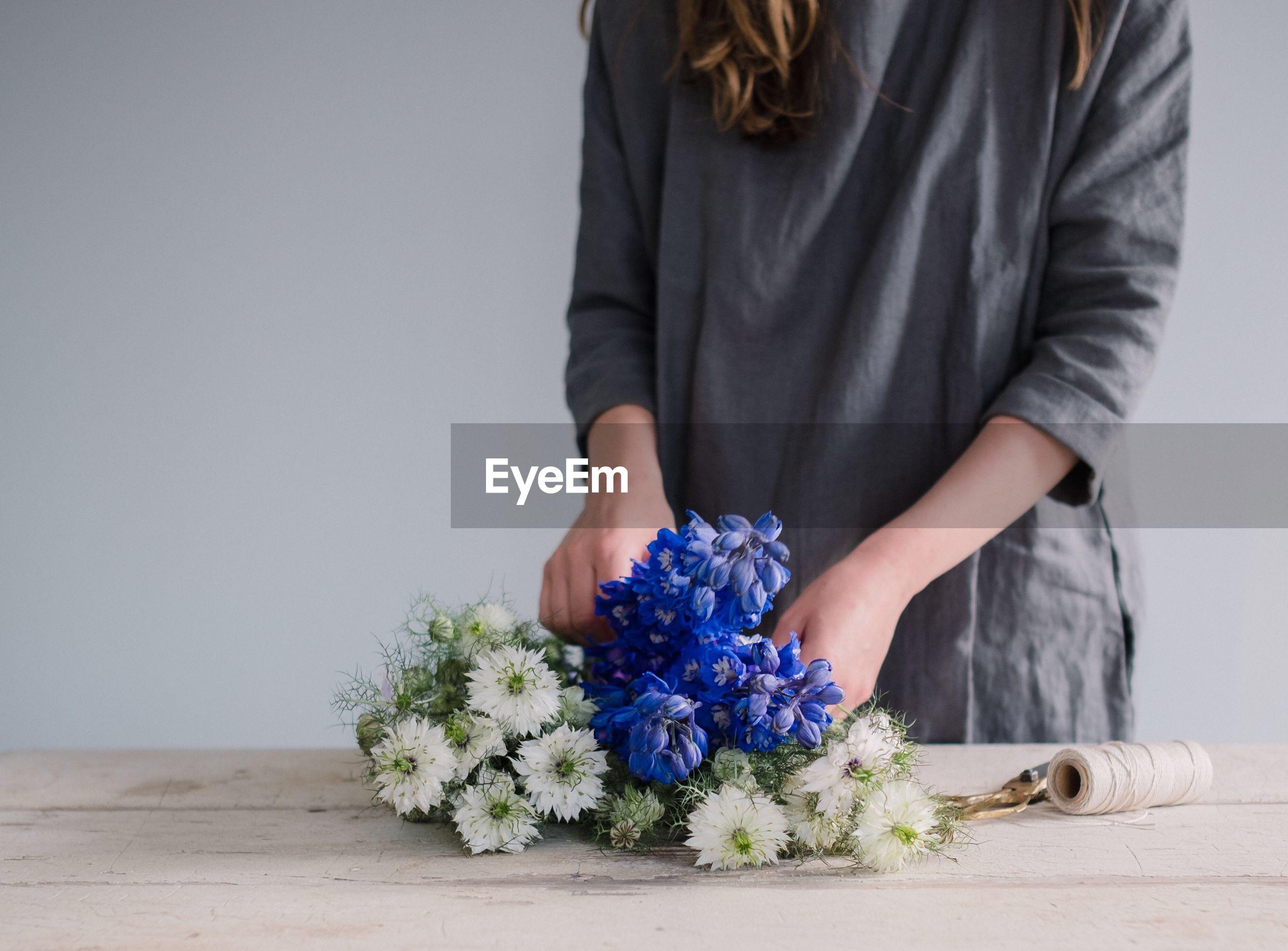 Woman making a flower arrangement