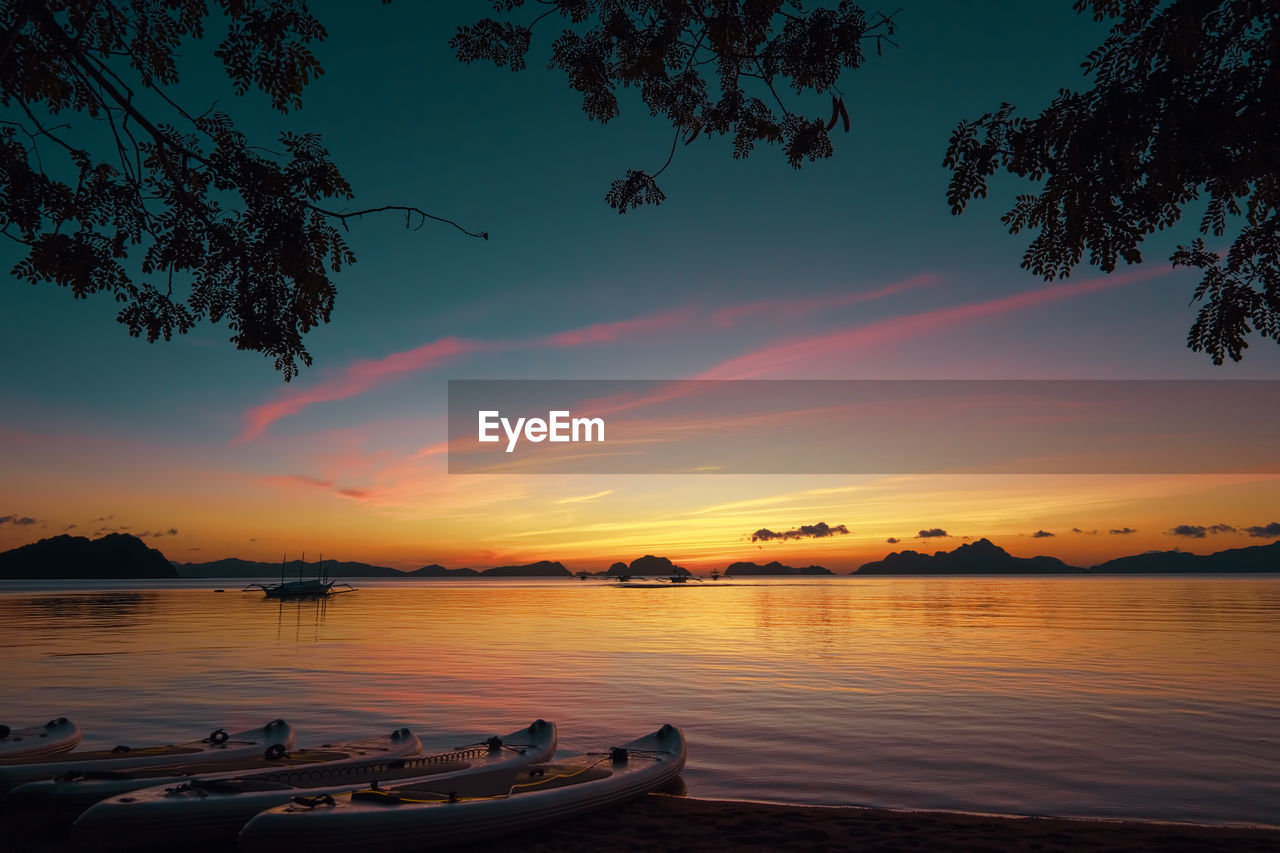sunset, beauty in nature, nature, sky, water, tree, scenics, tranquility, outdoors, tranquil scene, nautical vessel, no people, day