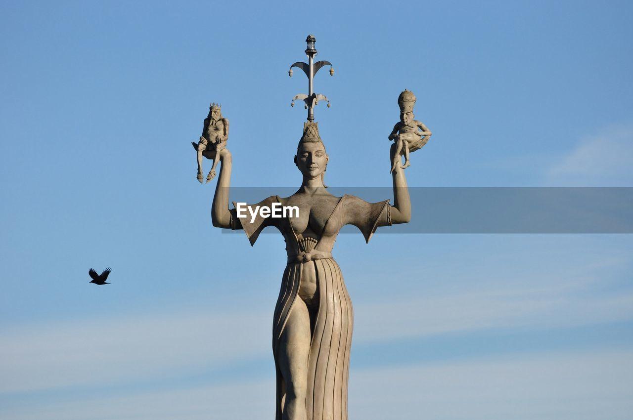 Statue of imperia against blue sky
