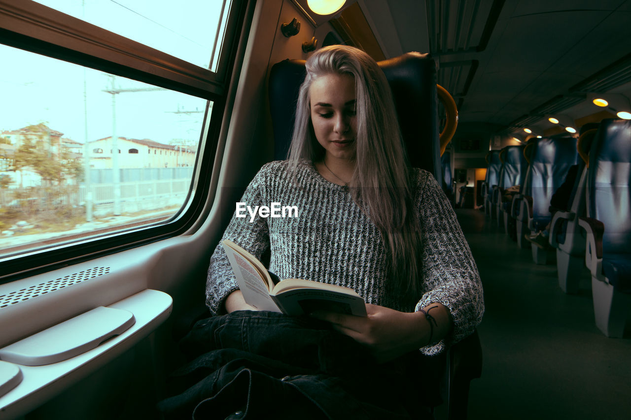 Young Woman Sitting In Train