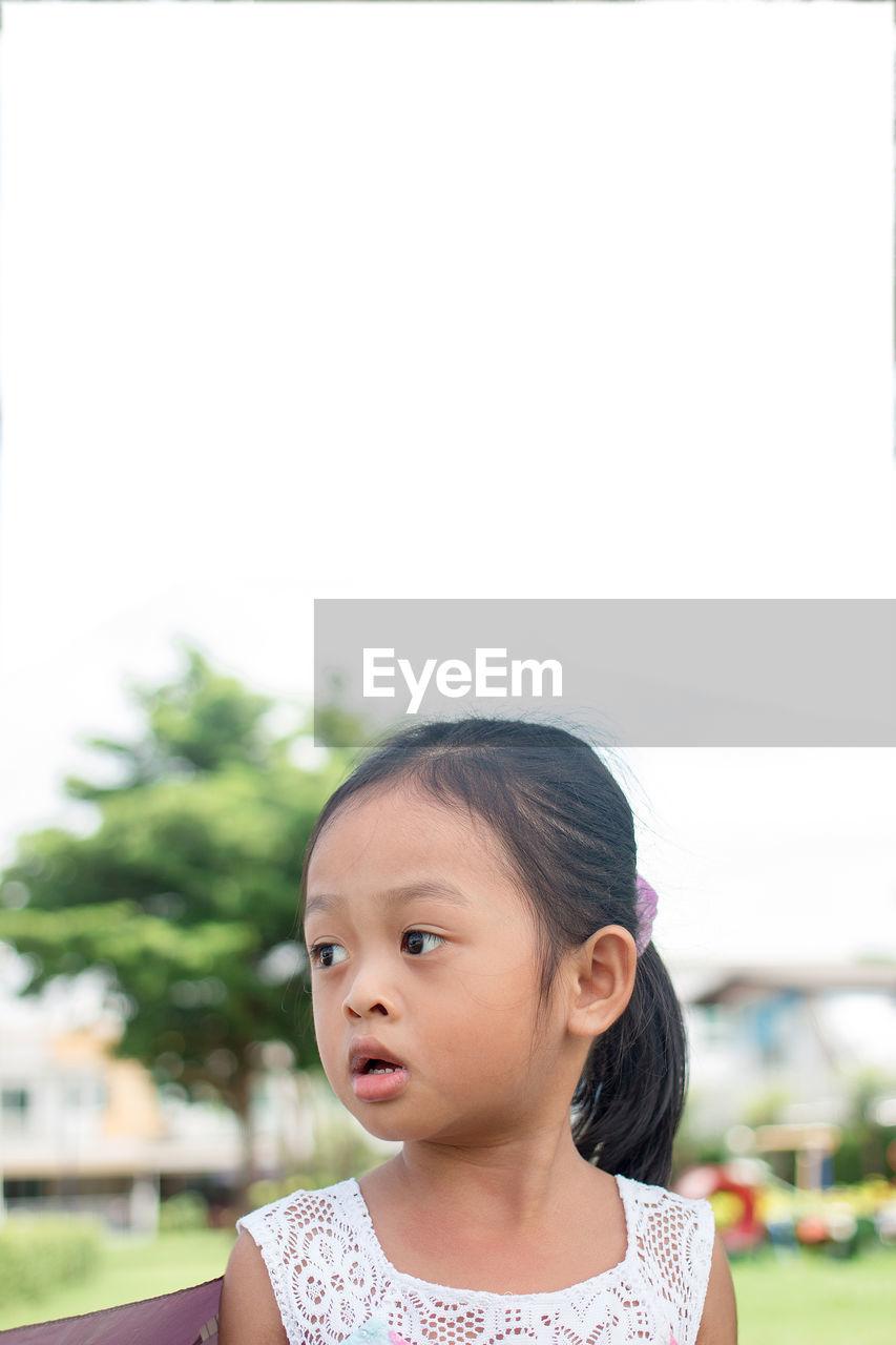 Innocent girl looking away
