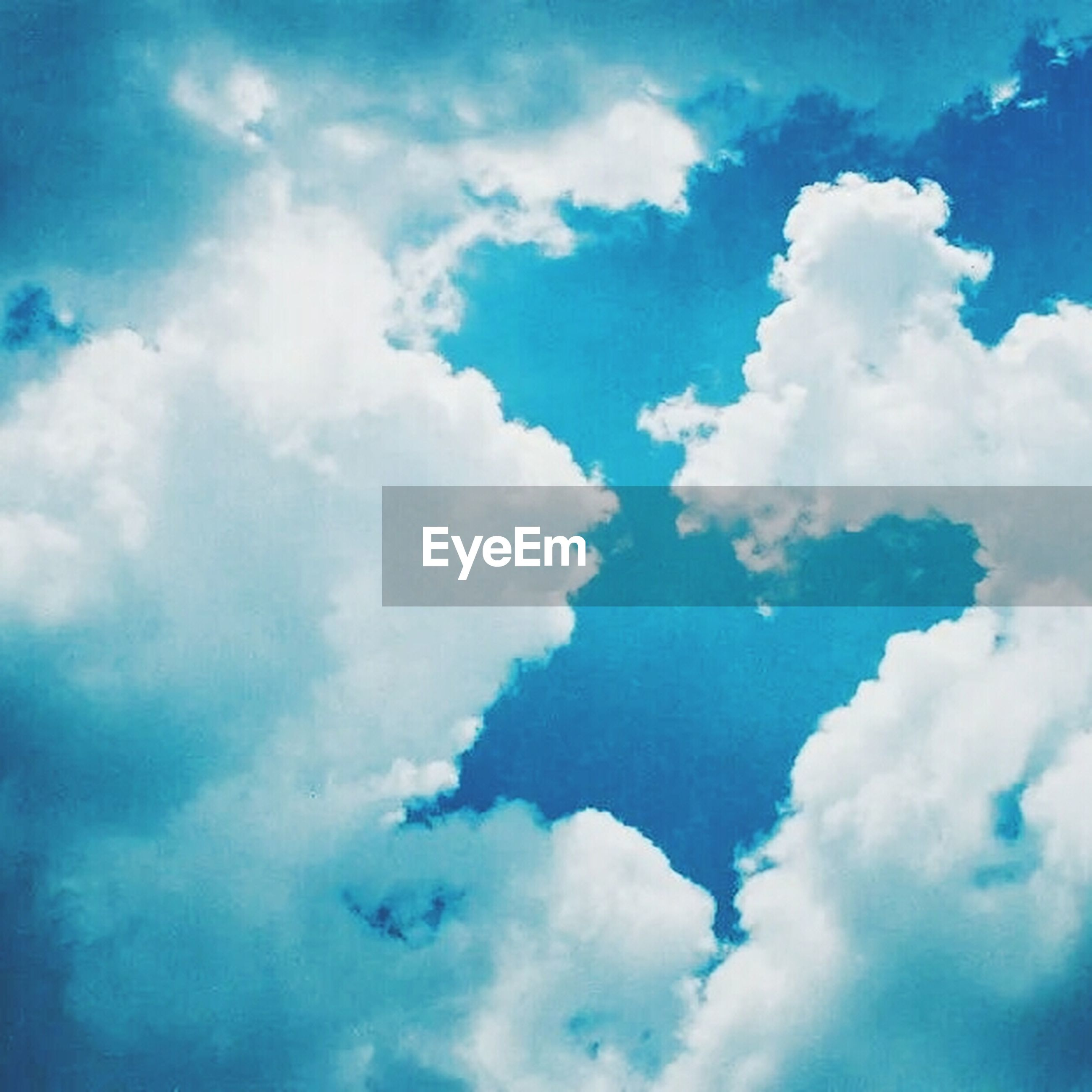 sky, low angle view, cloud - sky, blue, sky only, beauty in nature, cloudy, tranquility, nature, cloudscape, scenics, backgrounds, cloud, tranquil scene, full frame, white color, idyllic, fluffy, outdoors, day