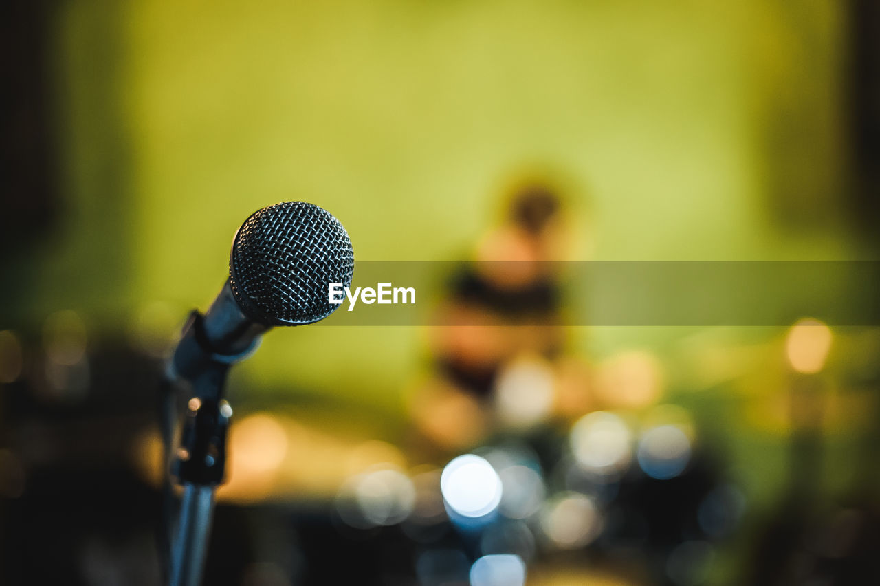 Close-Up Of Microphone Against Defocused Lights