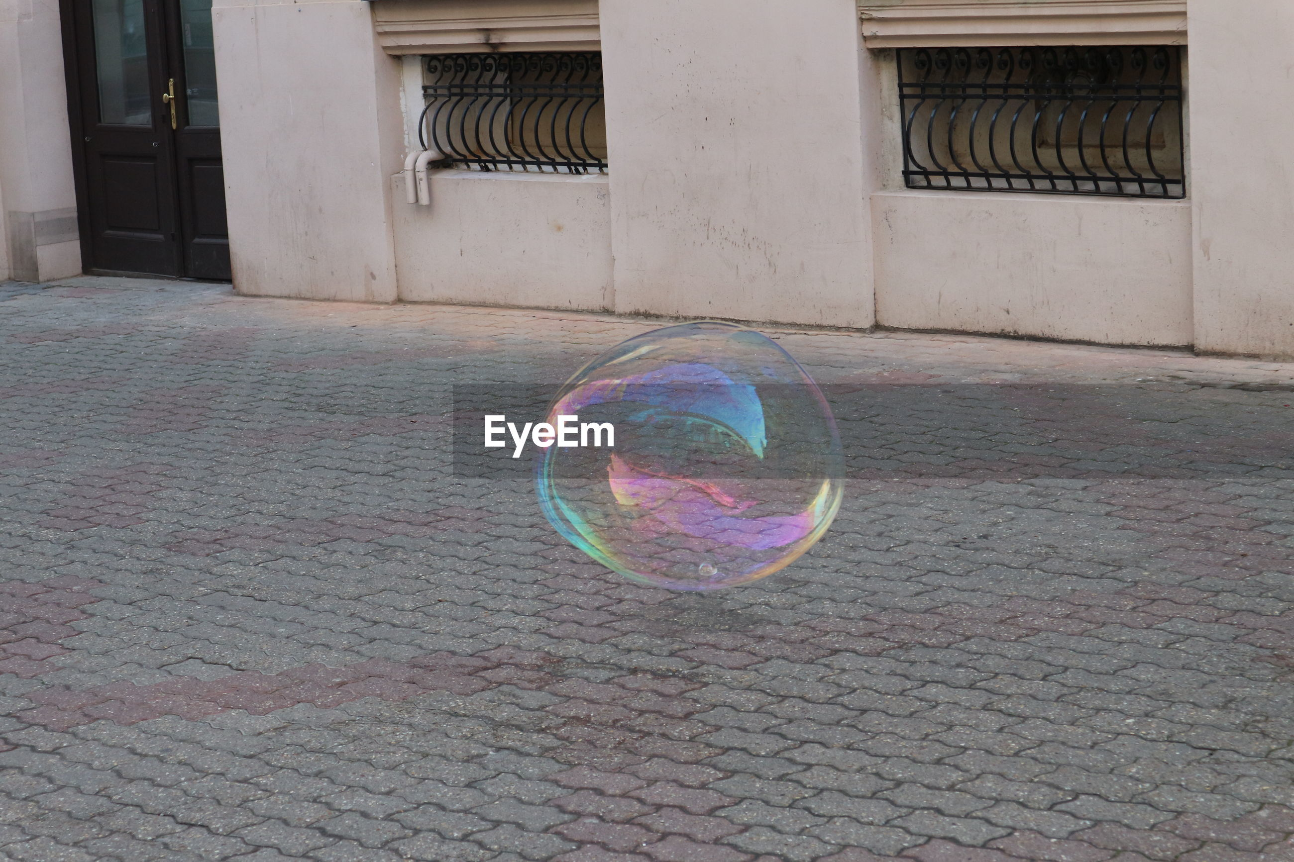 Multi colored bubbles in front of building