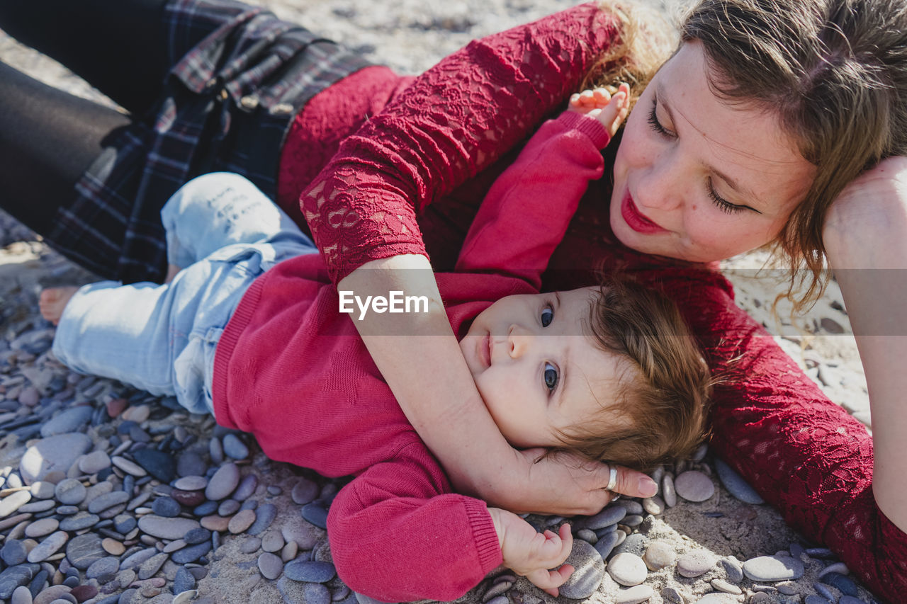 High angle view of mother and daughter at beach