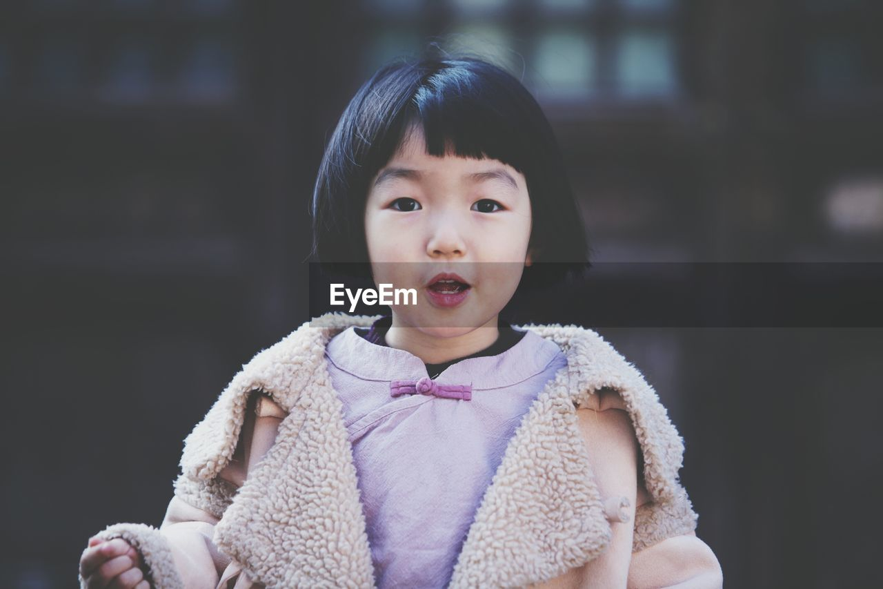 Portrait of cute girl wearing warm clothing