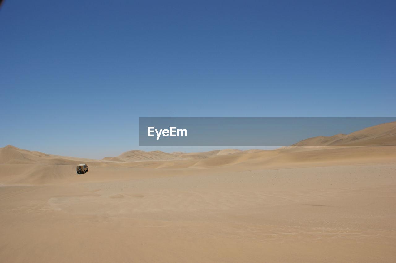 Distant Car In Desert