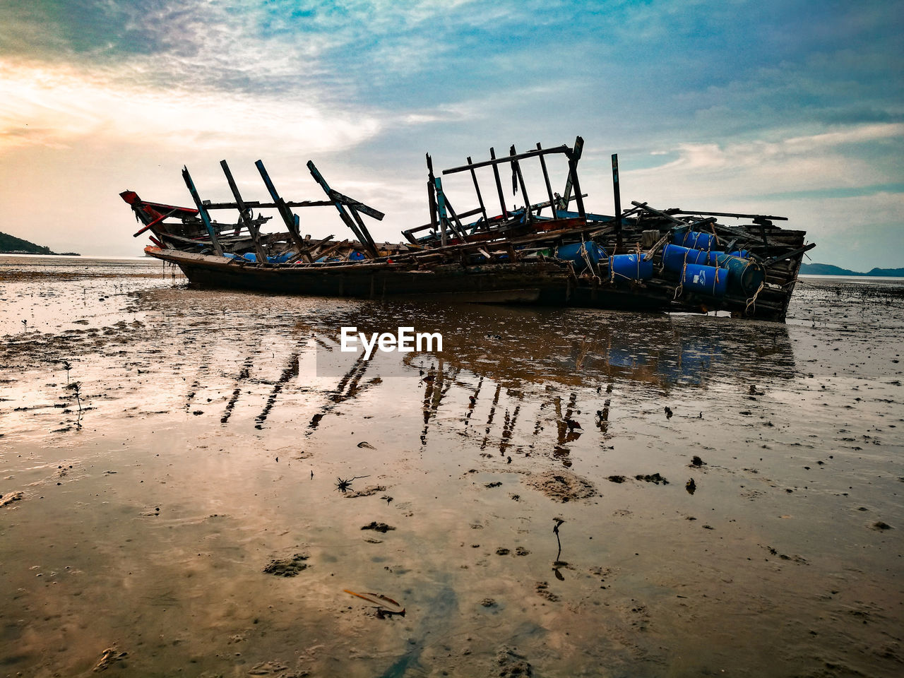 sky, nautical vessel, water, transportation, mode of transportation, cloud - sky, sea, beach, nature, land, no people, reflection, scenics - nature, beauty in nature, moored, outdoors, sand, tranquility, day, fishing boat, fishing industry