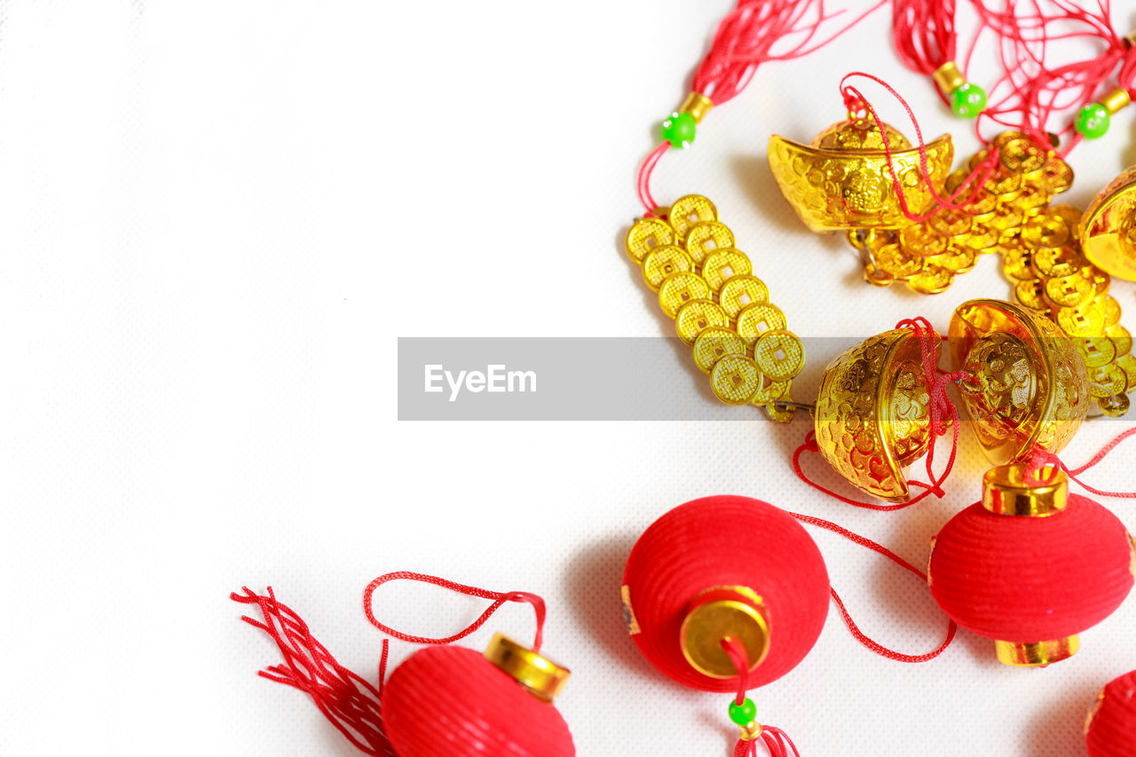 red, studio shot, white background, chinese new year, gold colored, celebration, no people, indoors, gold, chinese dragon, close-up