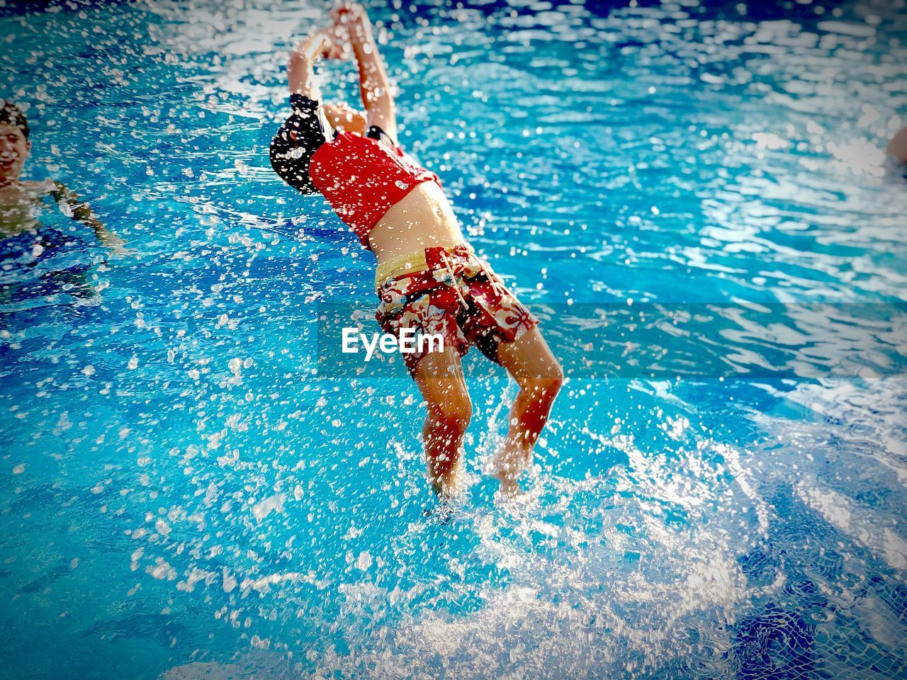 High angle view of boy jumping in pool