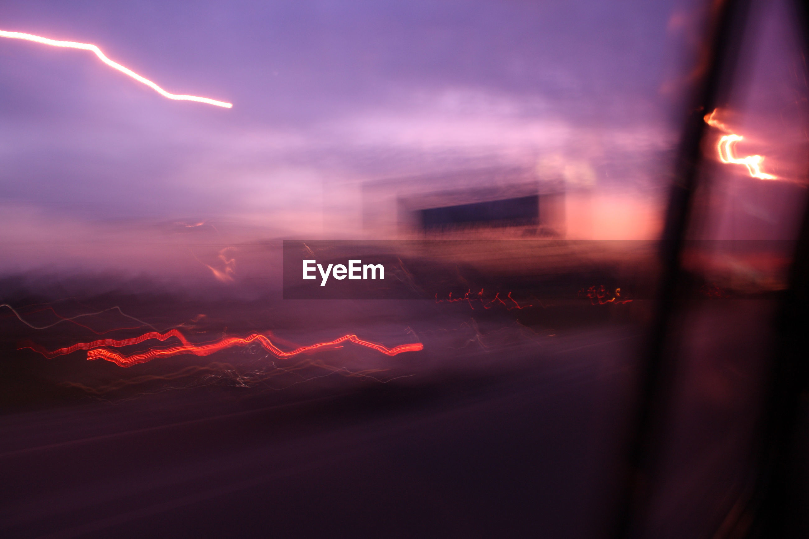 Light trail on highway seen from car window