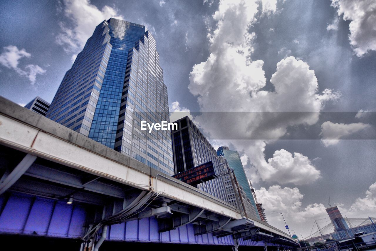 architecture, building exterior, low angle view, built structure, sky, skyscraper, day, outdoors, cloud - sky, modern, city, no people