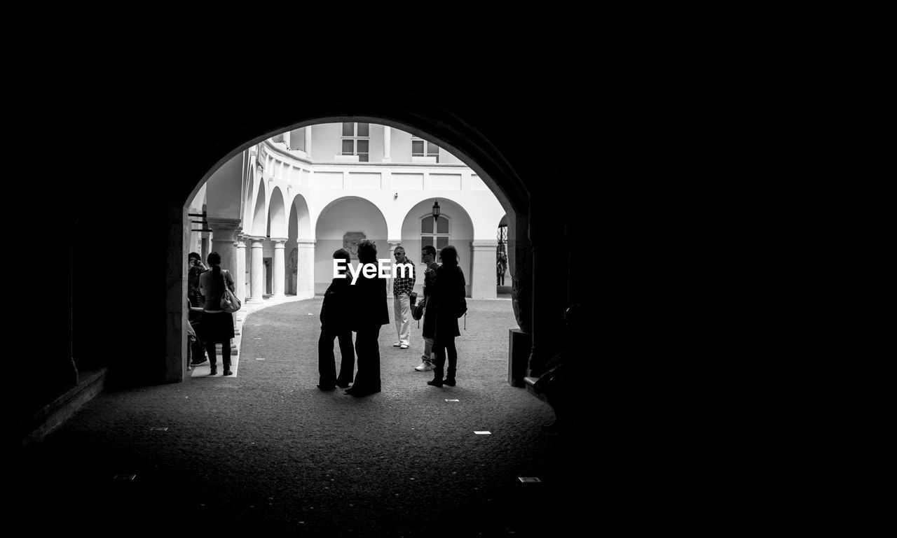 arch, silhouette, walking, real people, full length, indoors, togetherness, women, lifestyles, men, architecture, day, people, adult, adults only
