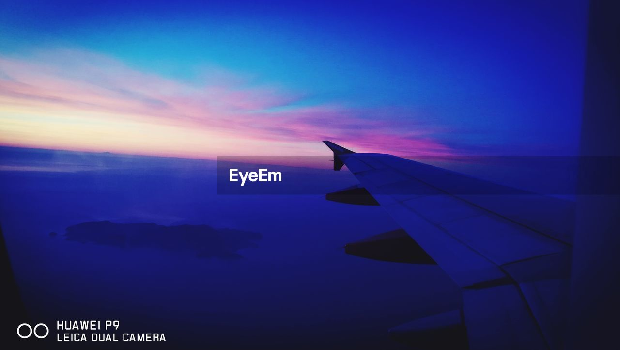 airplane, sunset, transportation, sky, journey, flying, airplane wing, cloud - sky, travel, air vehicle, no people, nature, blue, beauty in nature, aircraft wing, scenics, outdoors, close-up, day