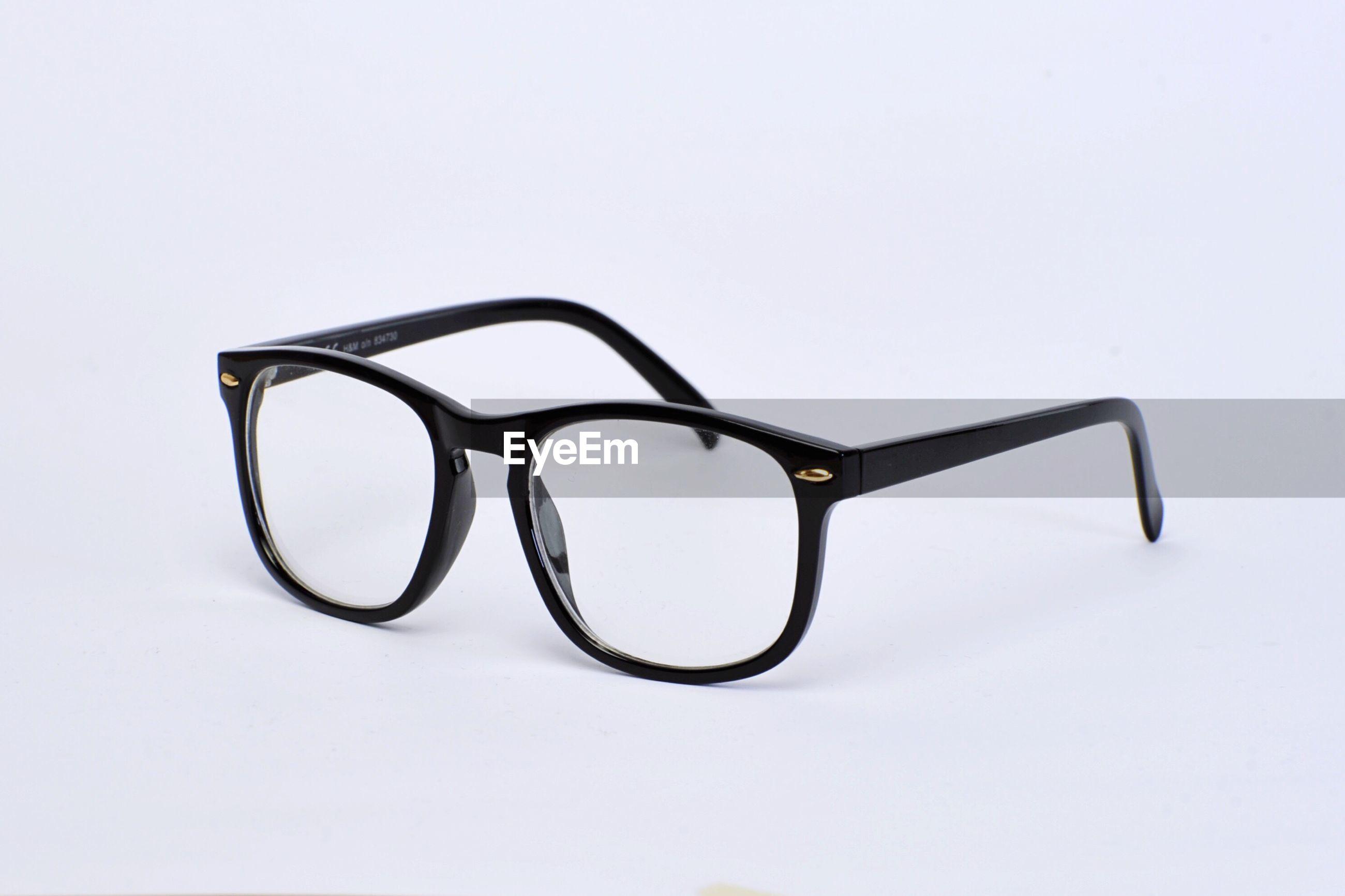 Close-up of eyeglasses over white background