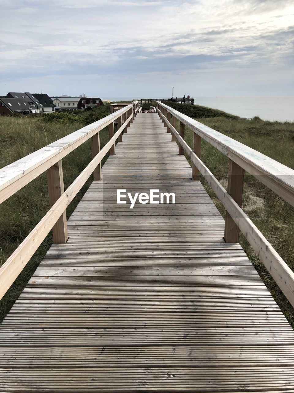 the way forward, sky, wood - material, direction, cloud - sky, diminishing perspective, nature, railing, no people, tranquility, connection, tranquil scene, bridge, day, wood, built structure, vanishing point, scenics - nature, non-urban scene, architecture, outdoors, wood paneling, footbridge, long