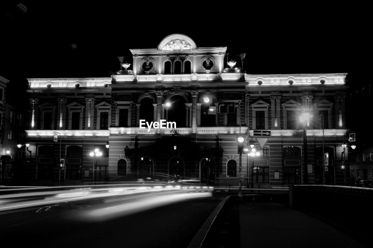 night, architecture, illuminated, motion, built structure, transportation, building exterior, road, city, street, speed, blurred motion, long exposure, no people, light trail, travel destinations, street light, sign, mode of transportation, road marking, architectural column