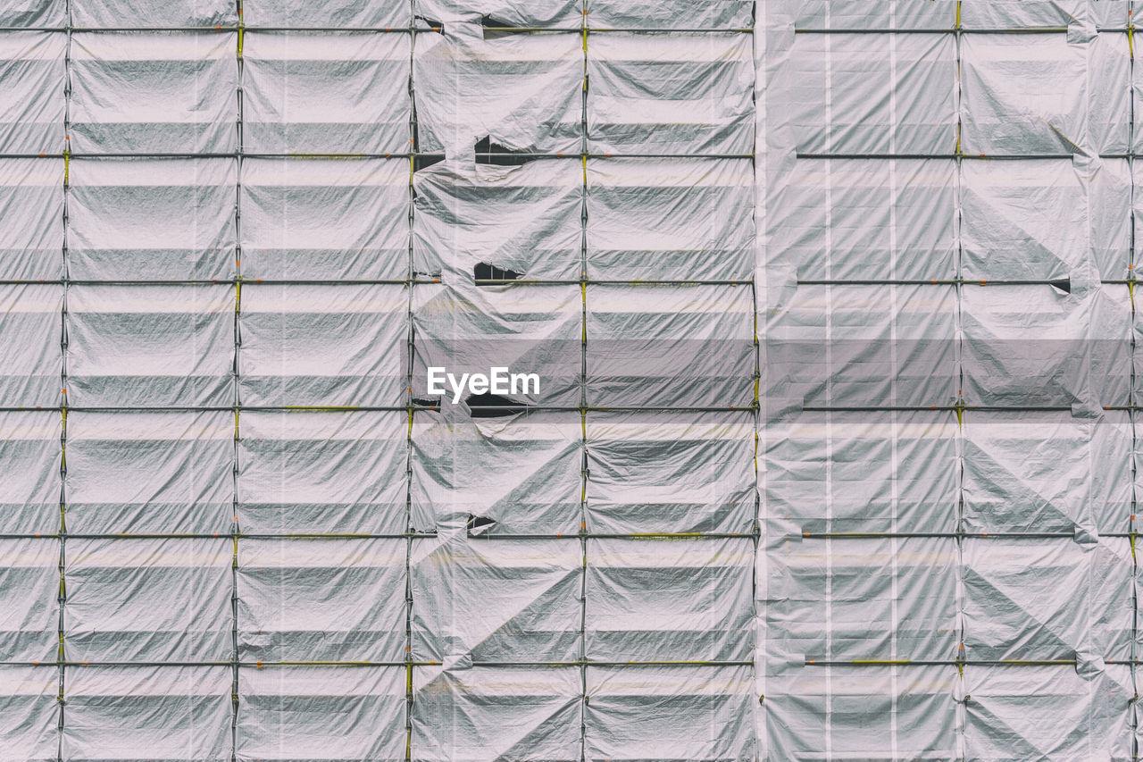 Full frame shot of tarpaulin on scaffolding
