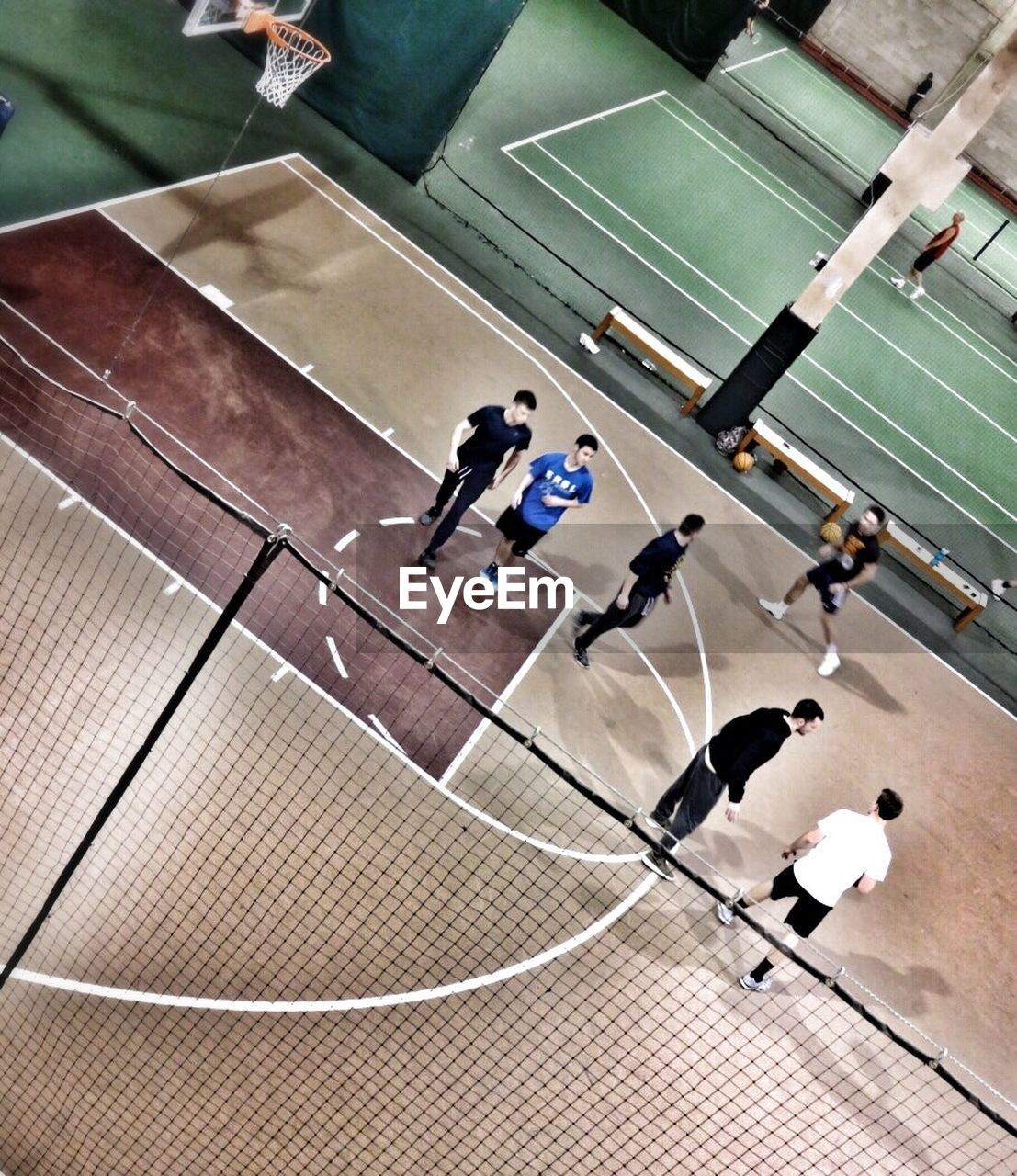 sport, high angle view, competition, playing, competitive sport, men, sportsman, sports clothing, real people, sports uniform, day, togetherness, teamwork, indoors, sports team, athlete, court, only men, people