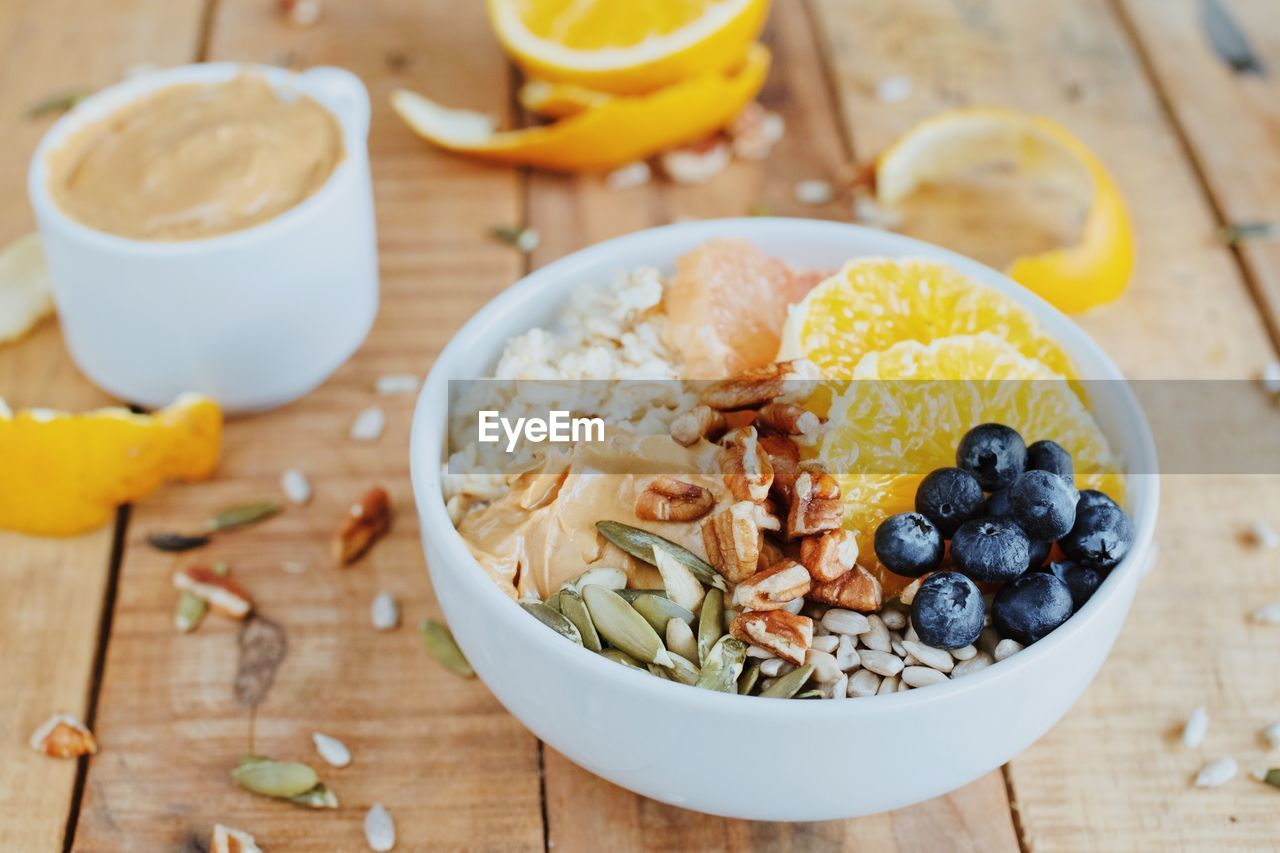 food and drink, food, healthy eating, freshness, wellbeing, fruit, table, bowl, still life, meal, high angle view, berry fruit, blueberry, ready-to-eat, indoors, breakfast, close-up, no people, focus on foreground, spoon