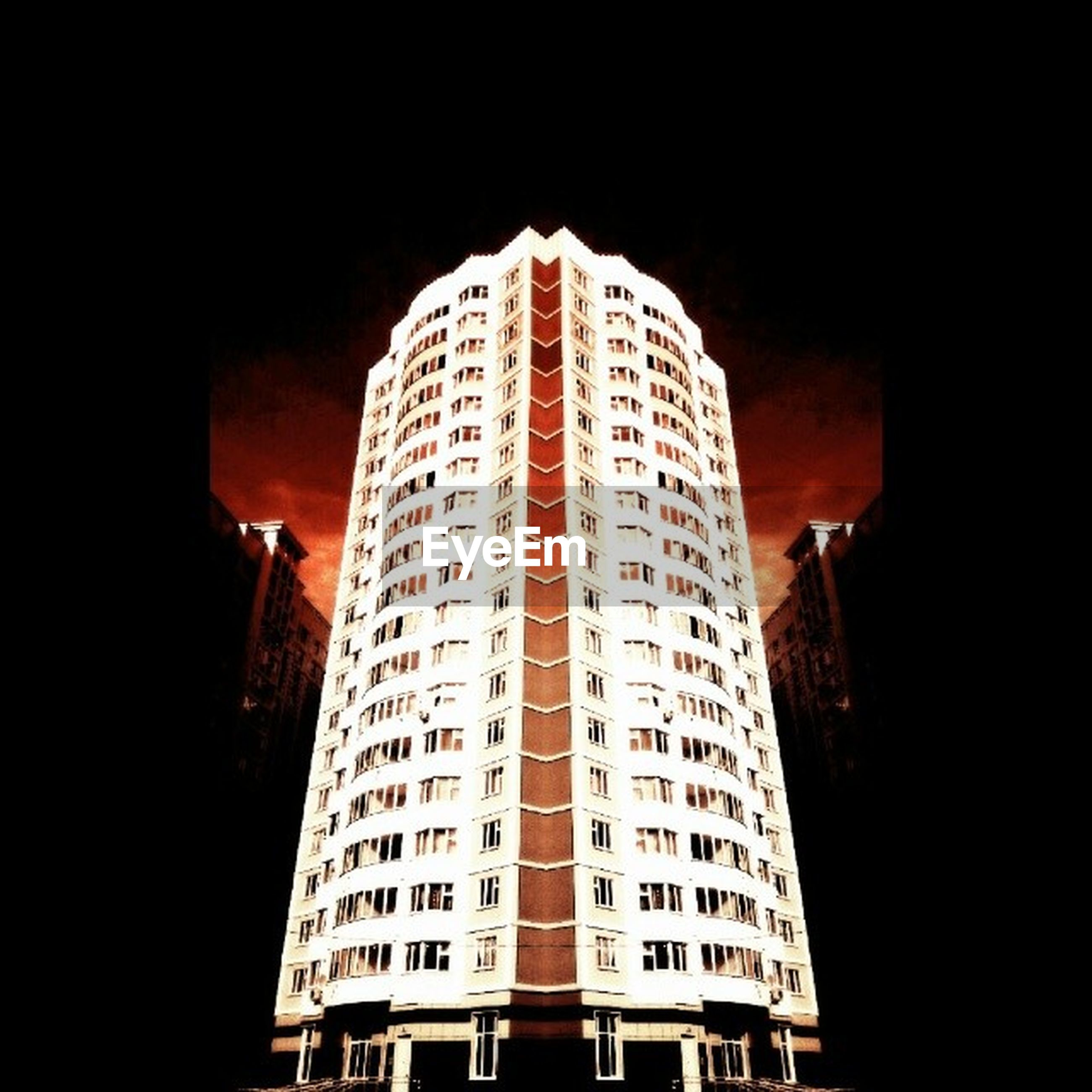 architecture, building exterior, built structure, skyscraper, low angle view, city, tower, tall - high, night, illuminated, modern, sky, office building, building, tall, outdoors, capital cities, travel destinations, city life, no people