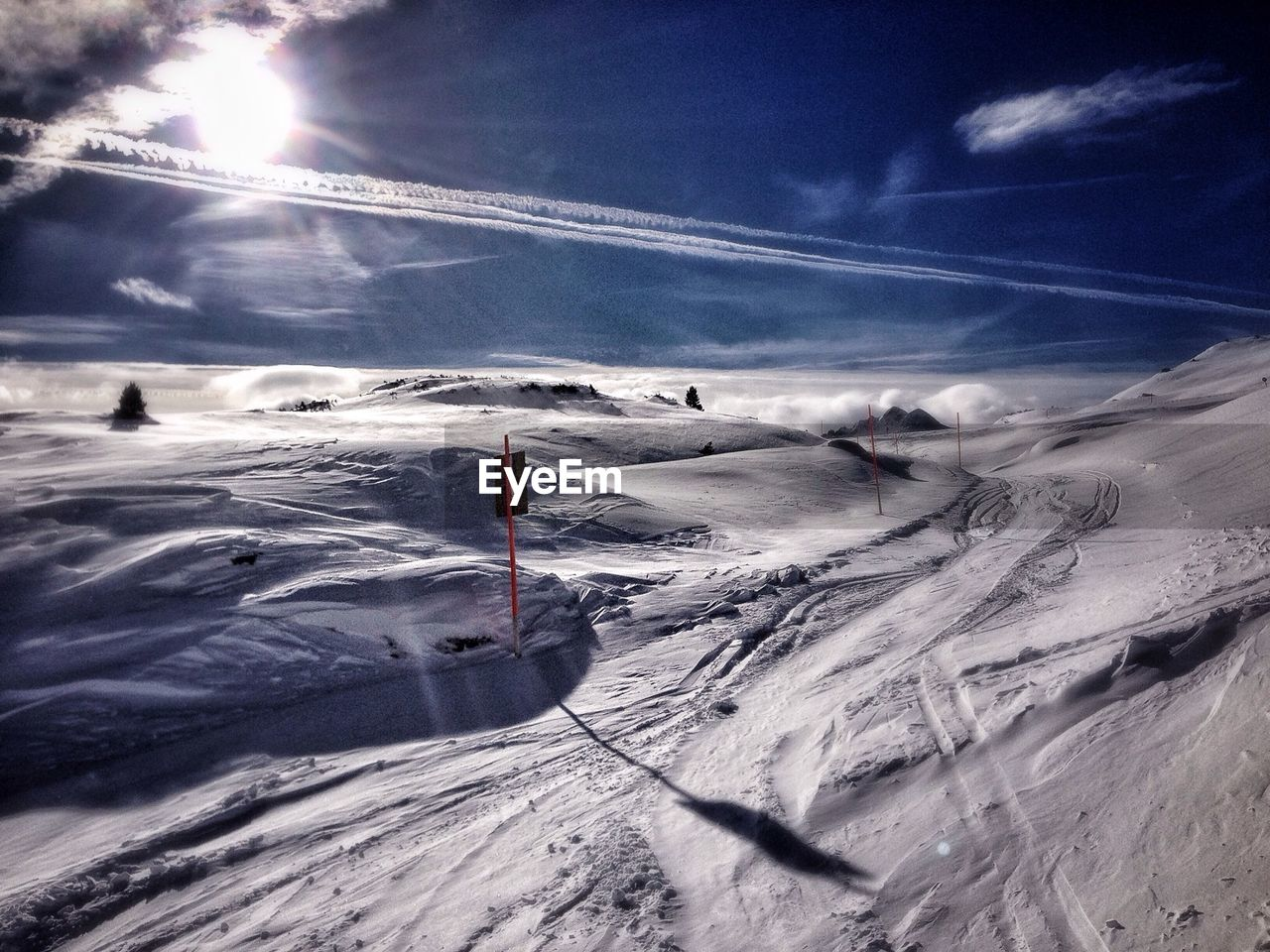 View of snow covered landscape on a sunny day