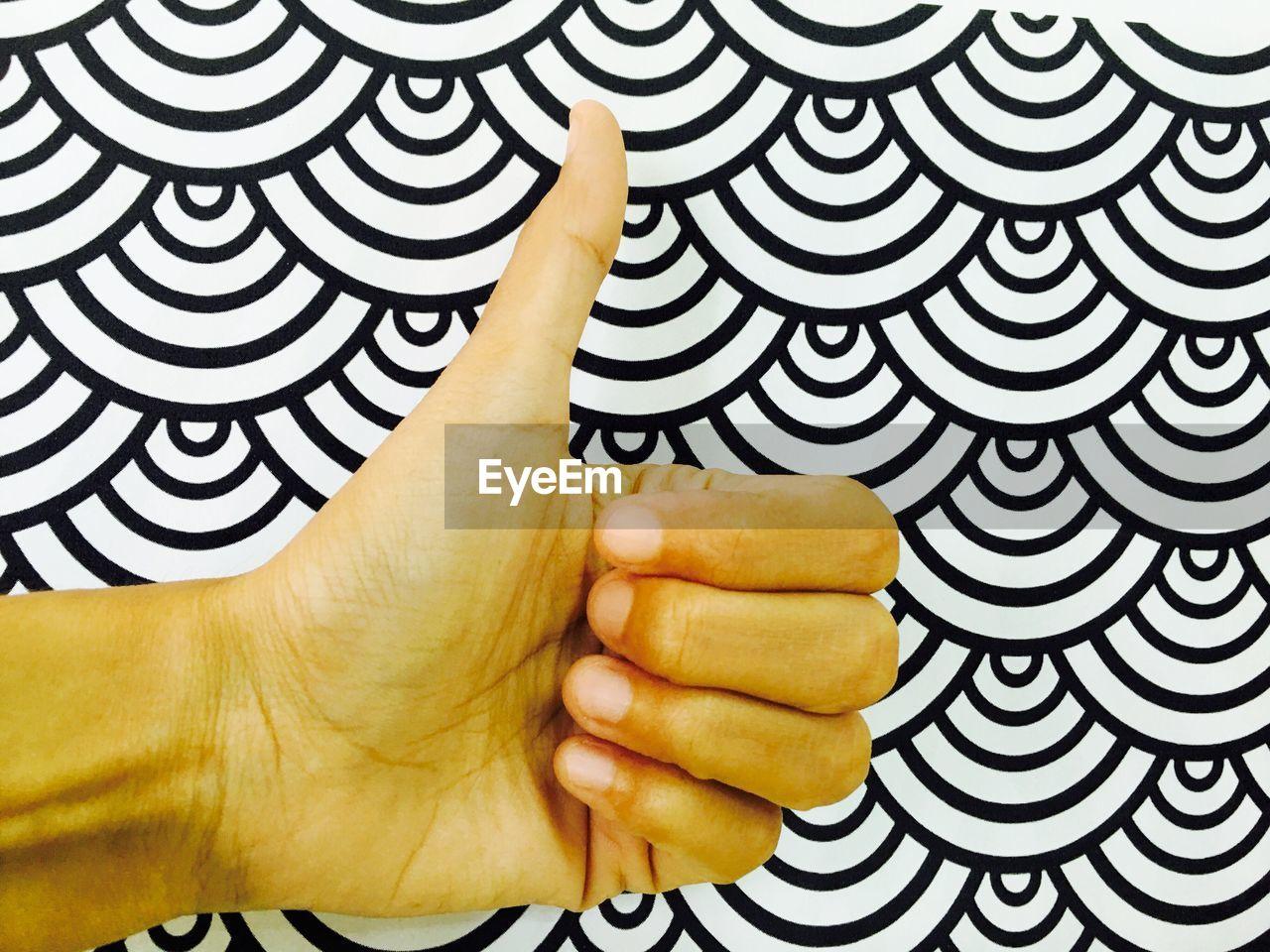 Studio Shot Of Human Hand Forming Thumbs Up