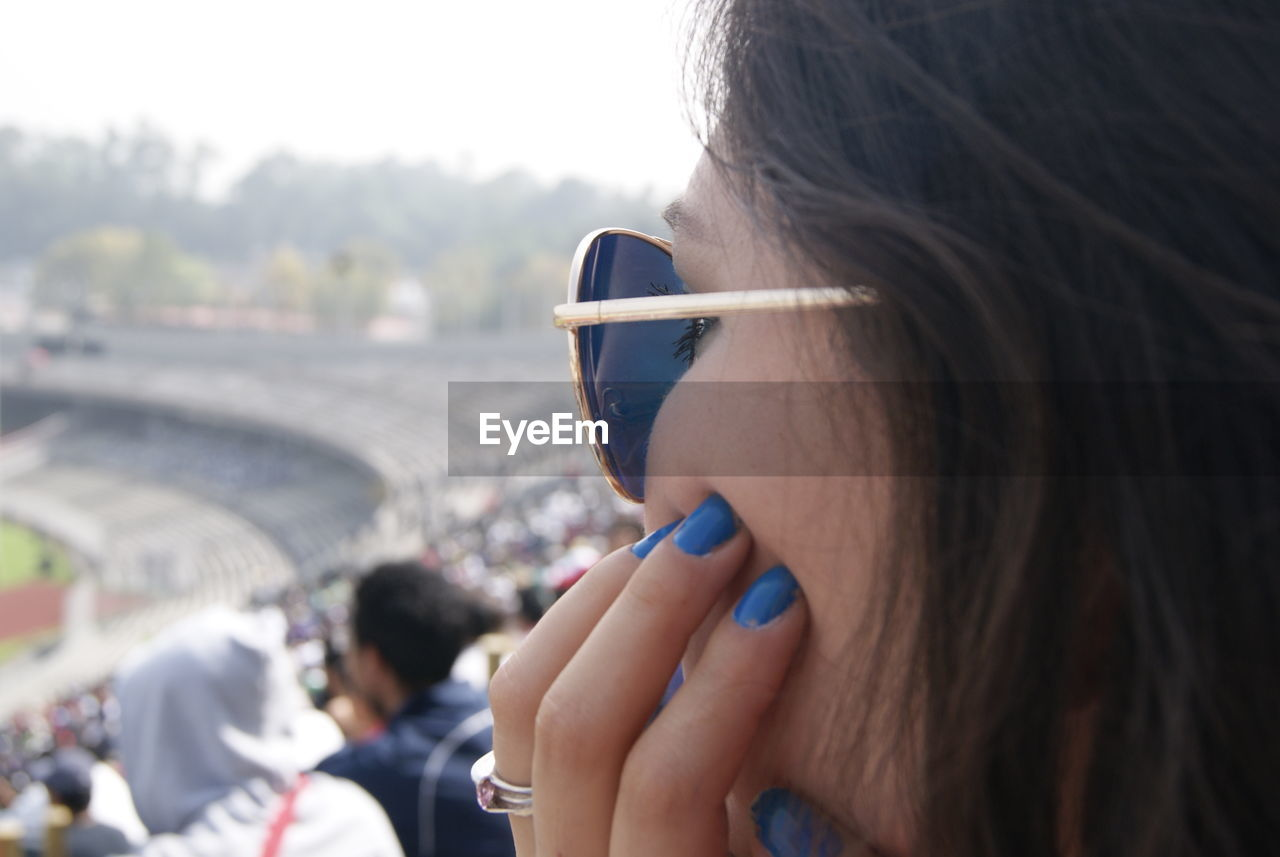 Close-Up Of Woman In Soccer Stadium