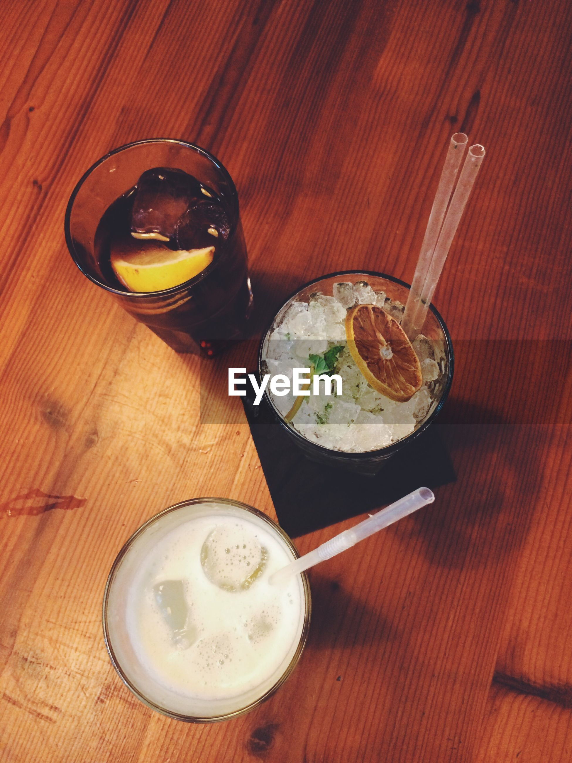 High angle view of drink in glasses on wooden table