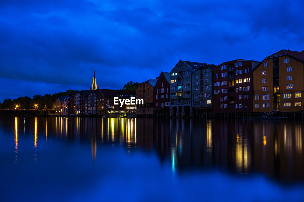 building exterior, built structure, architecture, reflection, illuminated, waterfront, water, sky, building, dusk, night, city, no people, nature, blue, river, cloud - sky, residential district