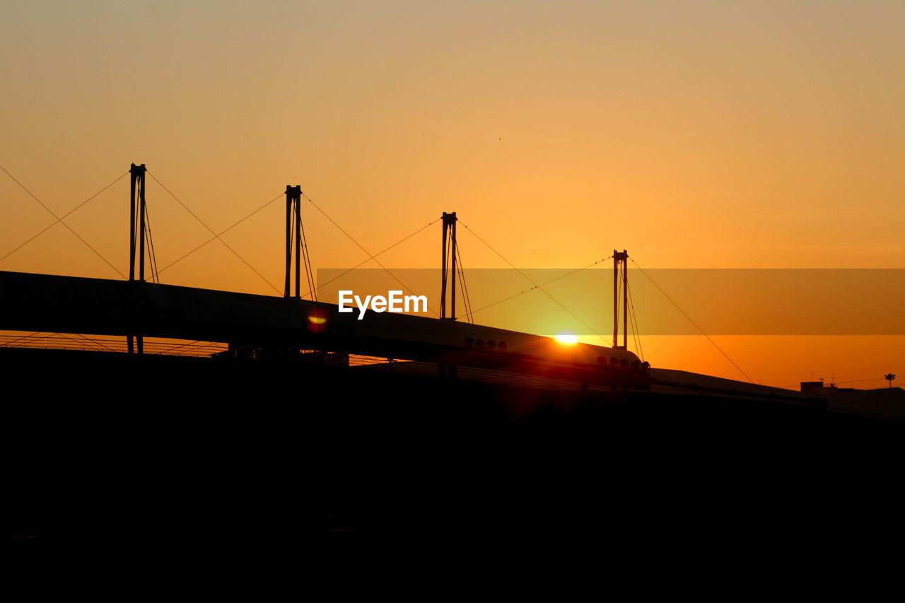 sunset, sky, connection, orange color, transportation, nature, bridge, architecture, bridge - man made structure, built structure, silhouette, sun, engineering, copy space, suspension bridge, sunlight, water, travel destinations, outdoors