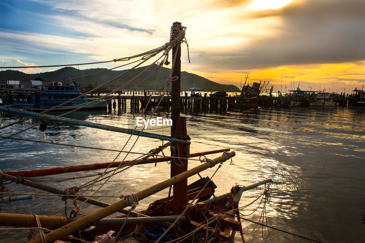 sky, sunset, water, nature, transportation, cloud - sky, beauty in nature, built structure, sea, scenics, nautical vessel, outdoors, no people, moored, architecture, outrigger, day