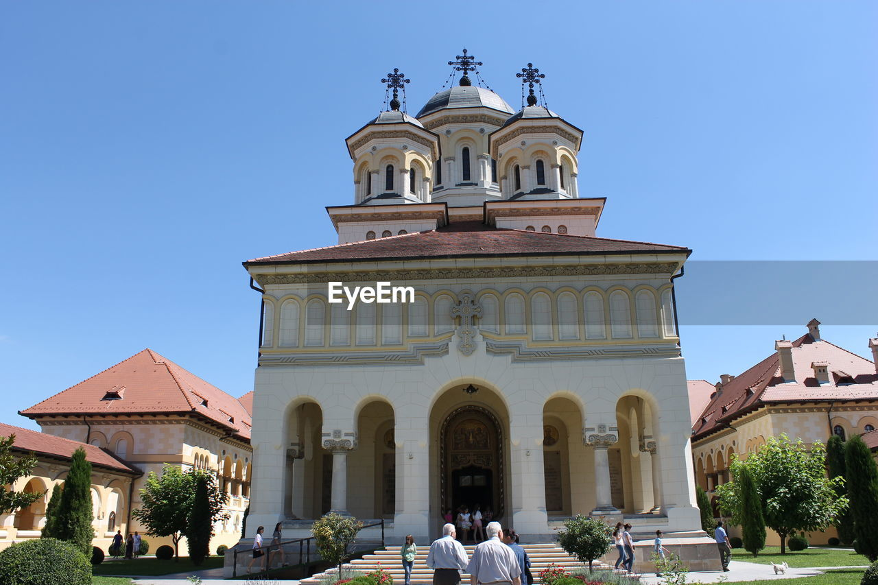 Tourists In Front Of Church