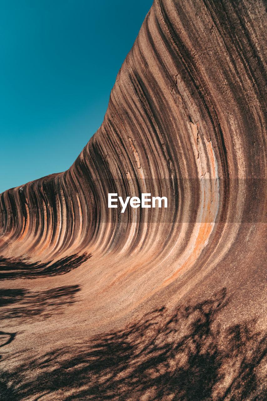 Rock formations in desert against sky
