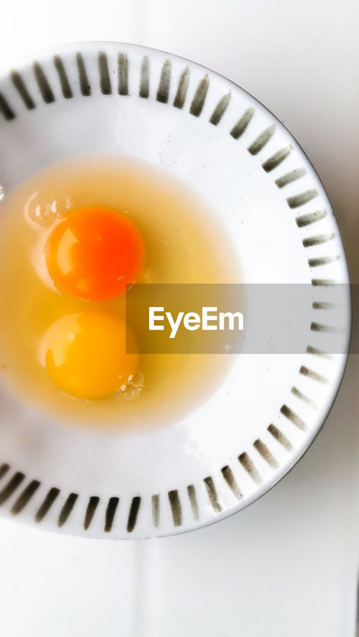 food and drink, food, indoors, egg, freshness, egg yolk, directly above, healthy eating, high angle view, close-up, no people, plate, table, fried egg, white background