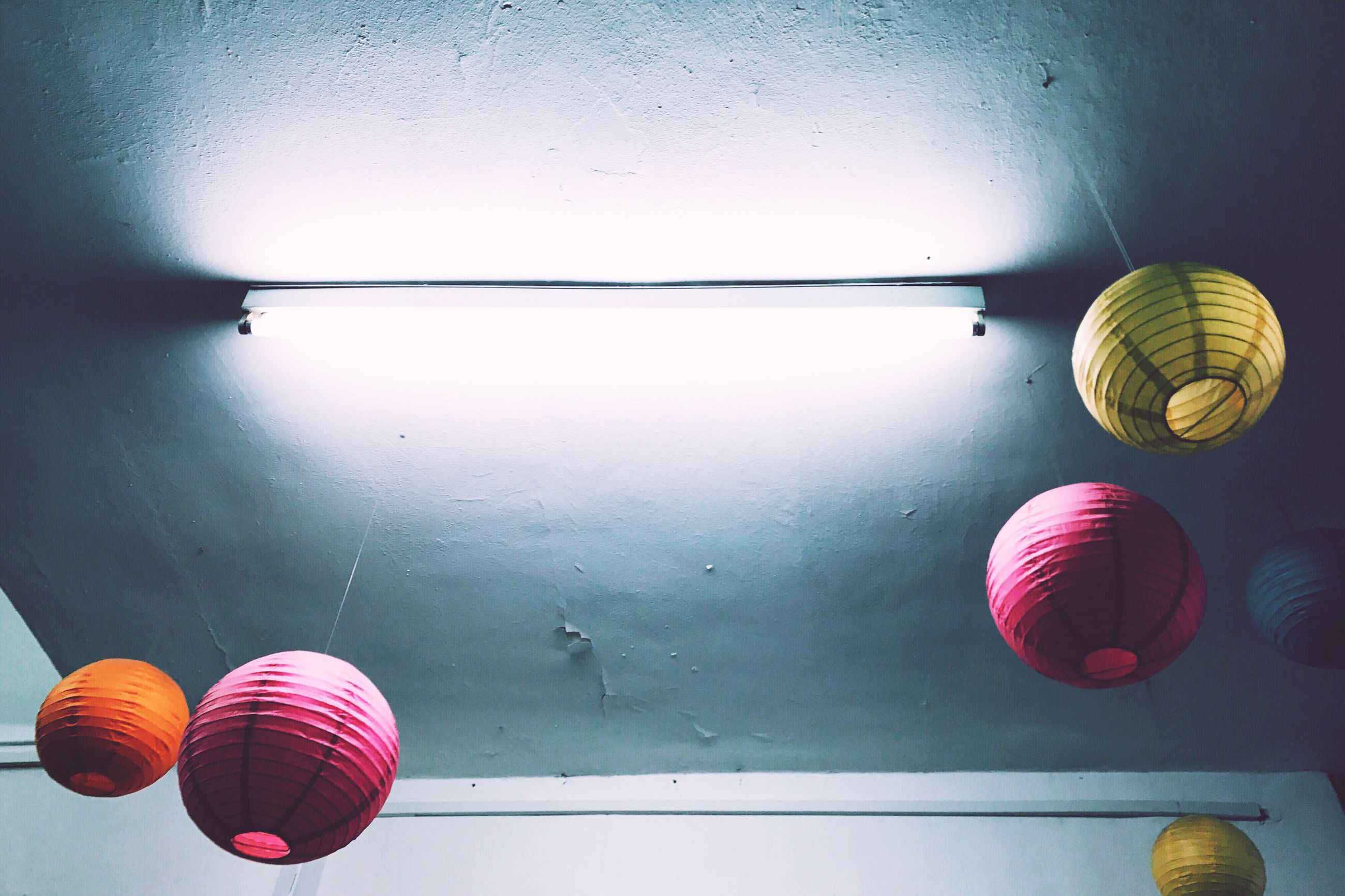 no people, multi colored, low angle view, indoors, day, ball, lantern, architecture, close-up