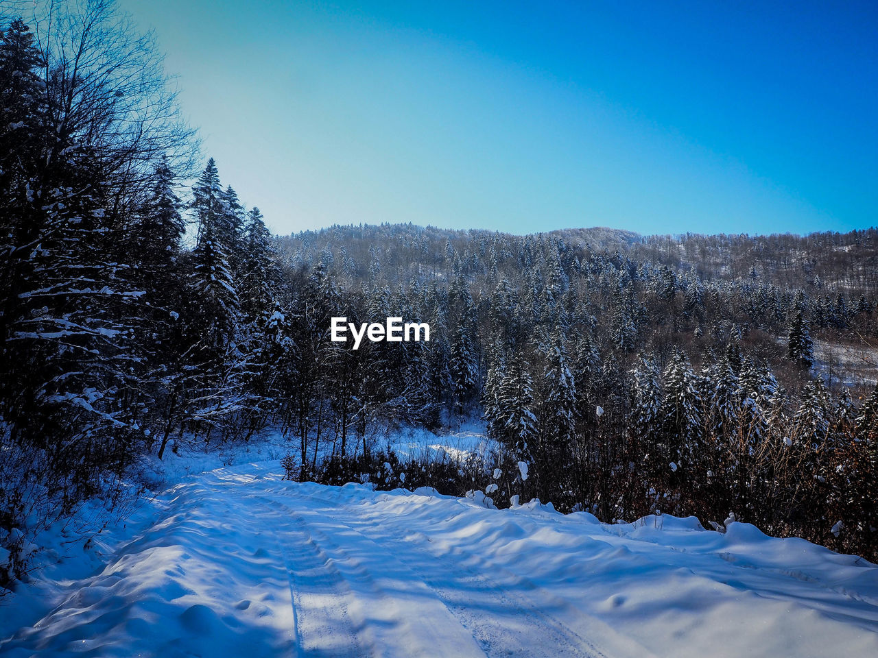 Snow Covered Land Against Clear Sky