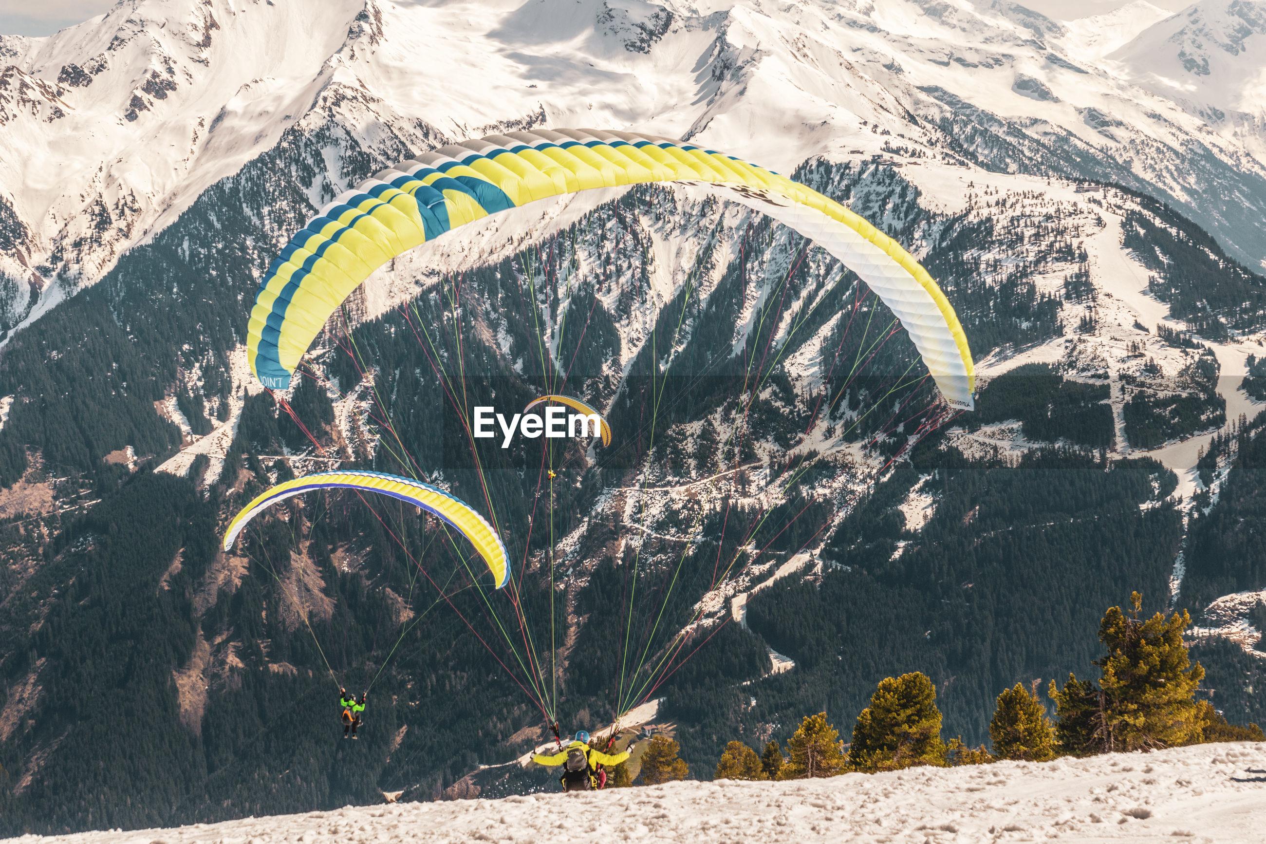 SCENIC VIEW OF SNOWCAPPED MOUNTAIN RANGE