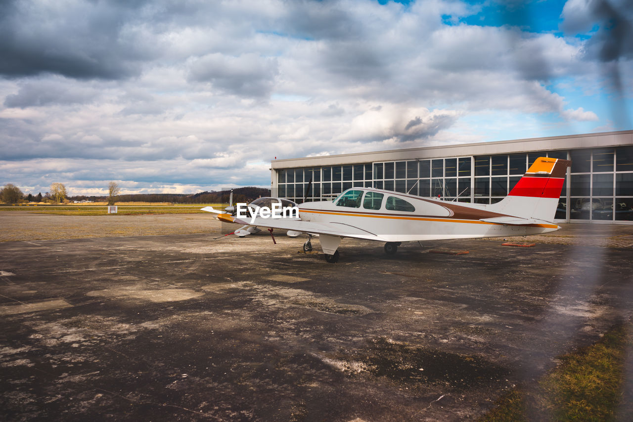 cloud - sky, sky, transportation, no people, airplane, day, air vehicle, airport, airport runway, outdoors, nature