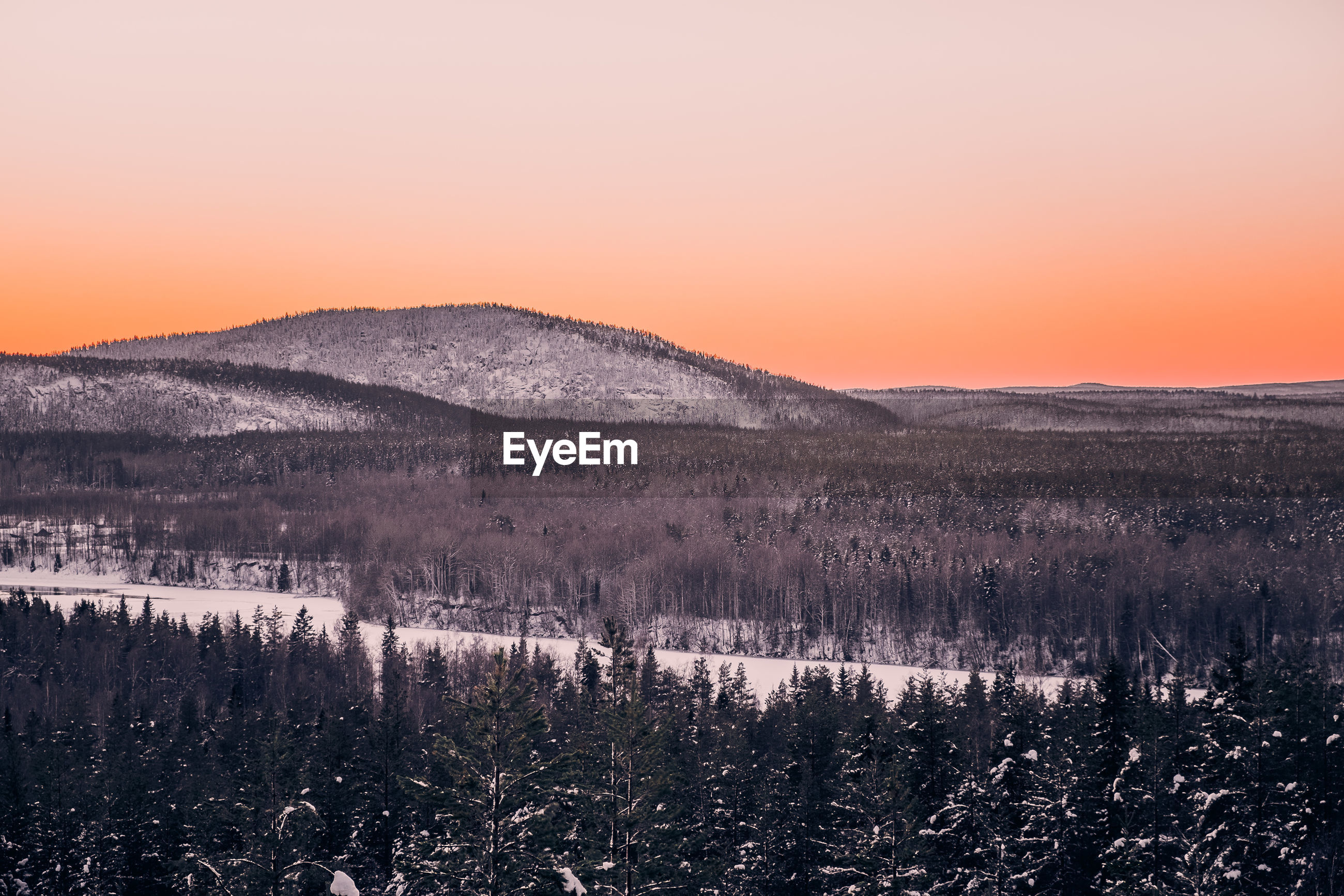 SCENIC VIEW OF LAND AGAINST CLEAR SKY DURING SUNSET