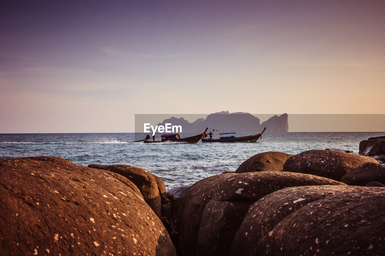 sea, water, sky, horizon over water, horizon, rock, scenics - nature, solid, rock - object, beauty in nature, nature, land, beach, transportation, no people, tranquil scene, sunset, nautical vessel, tranquility