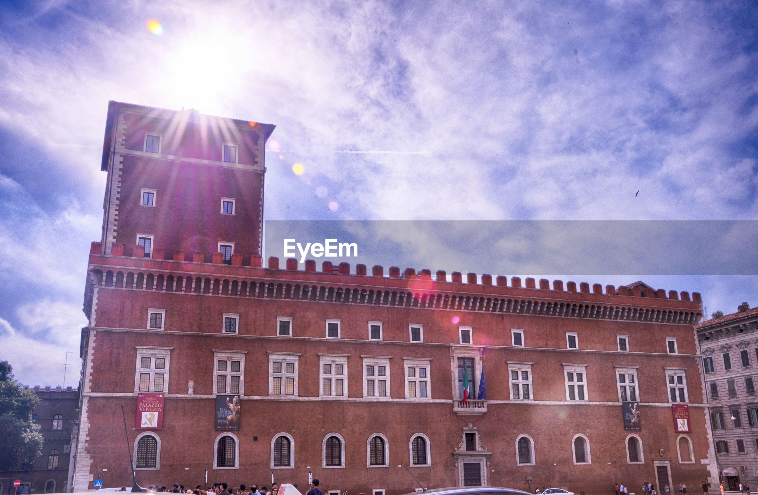 architecture, built structure, building exterior, low angle view, sky, window, cloud - sky, history, city, travel destinations, building, arch, tower, outdoors, travel, day, facade, famous place, old, sunlight