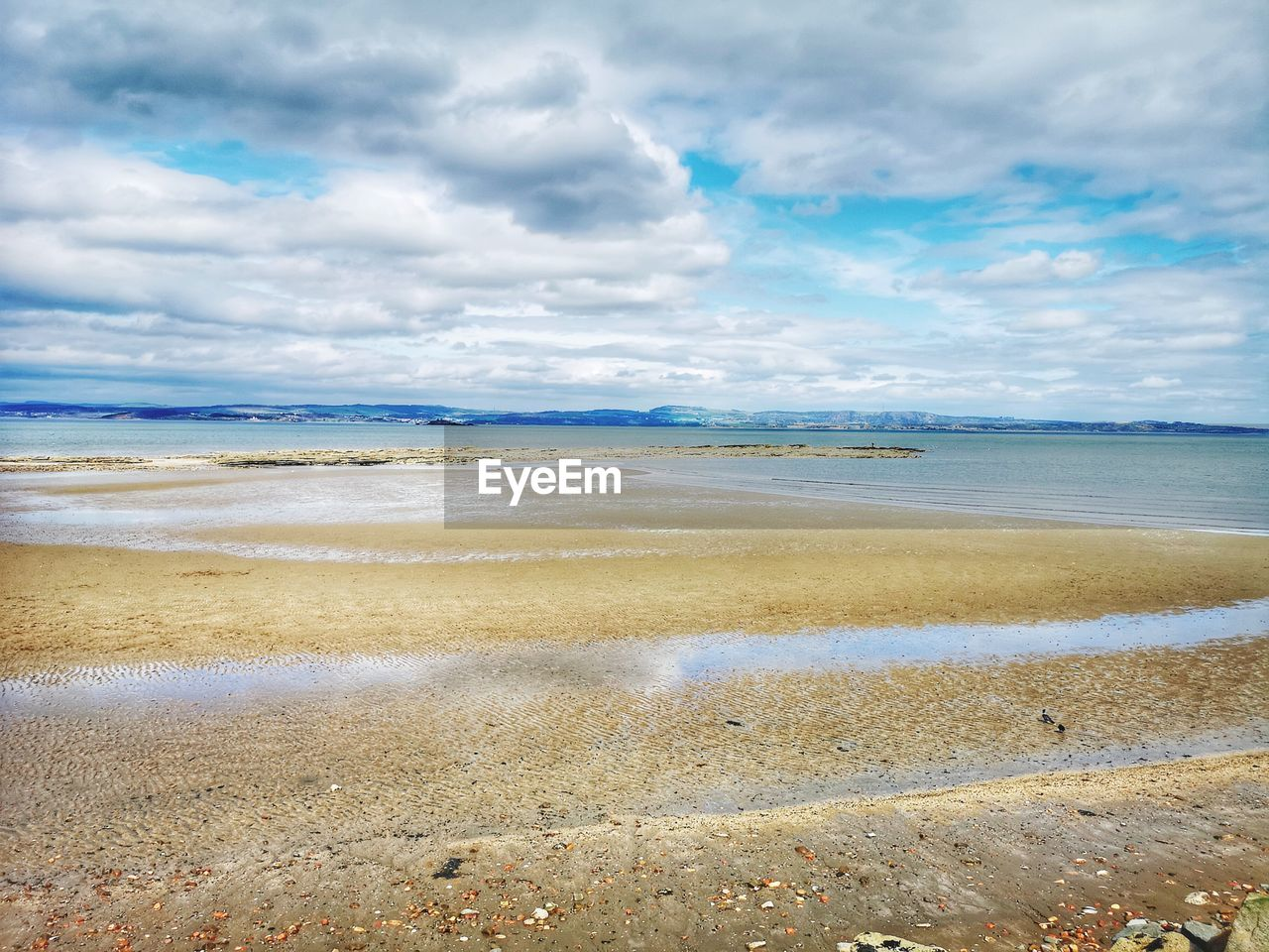 beach, cloud - sky, water, sky, land, sea, scenics - nature, beauty in nature, tranquil scene, tranquility, horizon over water, day, nature, horizon, sand, non-urban scene, no people, idyllic, wave, outdoors, low tide