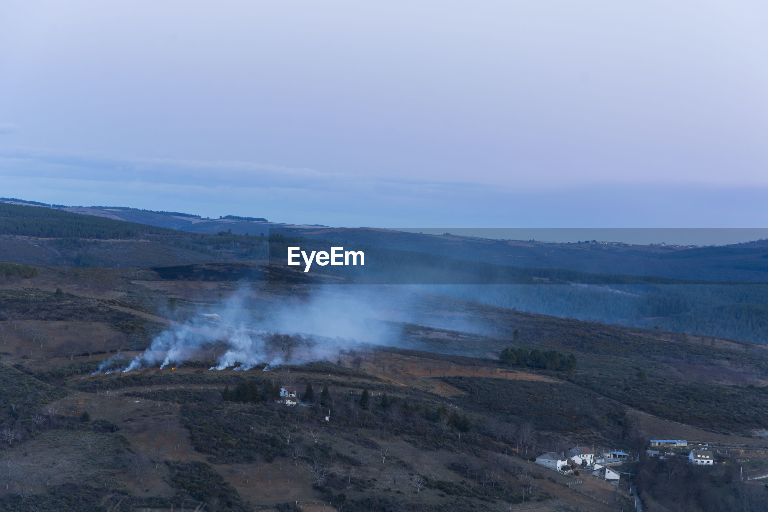 Aerial view of smoke emitting over land