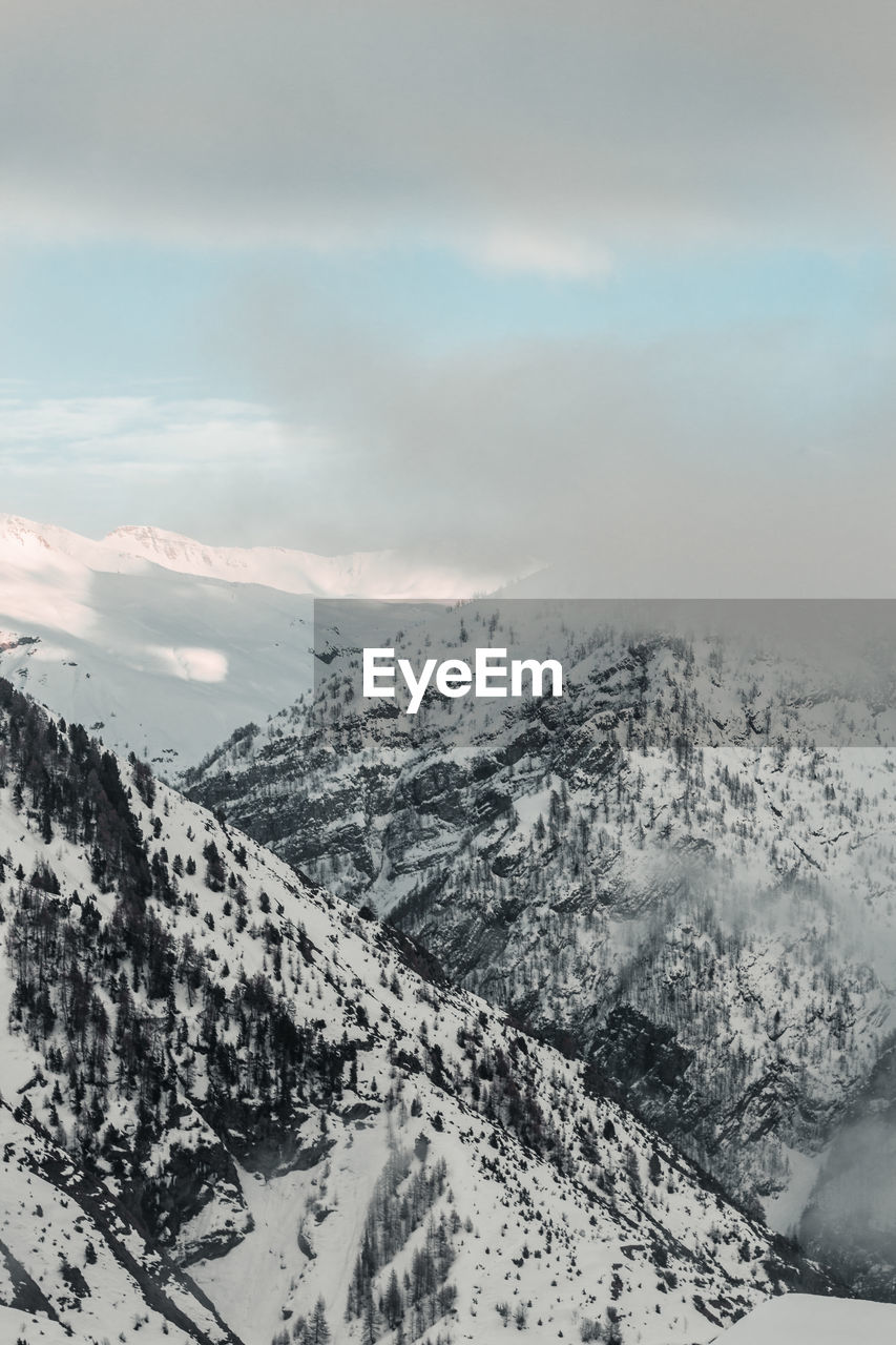 mountain, cloud - sky, beauty in nature, cold temperature, snow, scenics - nature, winter, tranquil scene, sky, tranquility, environment, landscape, nature, no people, mountain range, non-urban scene, day, idyllic, snowcapped mountain, outdoors, mountain peak, range