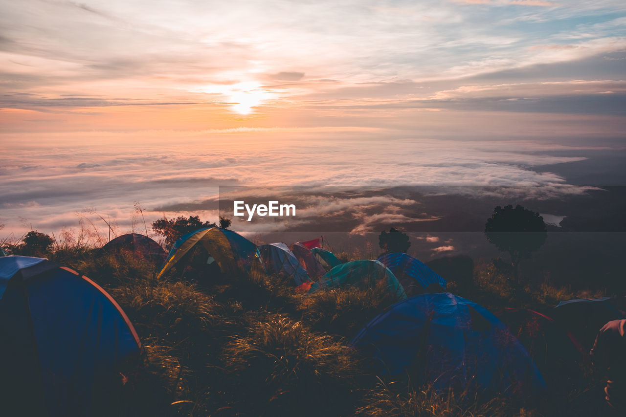 High angle view of tents on mountain against sky during sunset