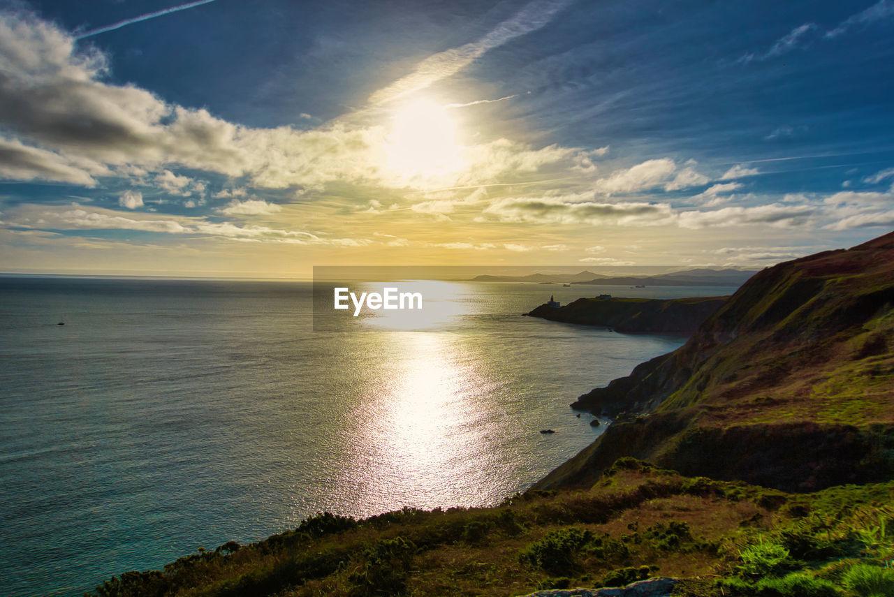 sky, scenics - nature, beauty in nature, water, tranquility, tranquil scene, cloud - sky, sea, sunset, land, beach, non-urban scene, idyllic, nature, sun, horizon over water, sunlight, horizon, no people, outdoors