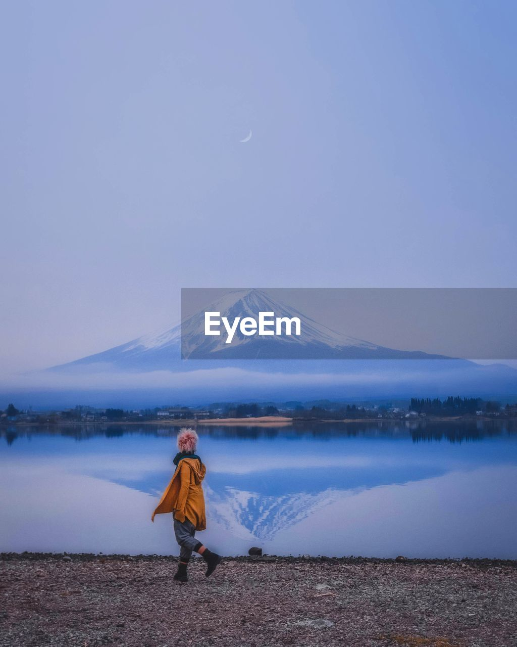 mountain, sky, water, one person, beauty in nature, lake, scenics - nature, full length, tranquil scene, tranquility, winter, real people, standing, nature, cold temperature, non-urban scene, rear view, leisure activity, snowcapped mountain, outdoors, warm clothing